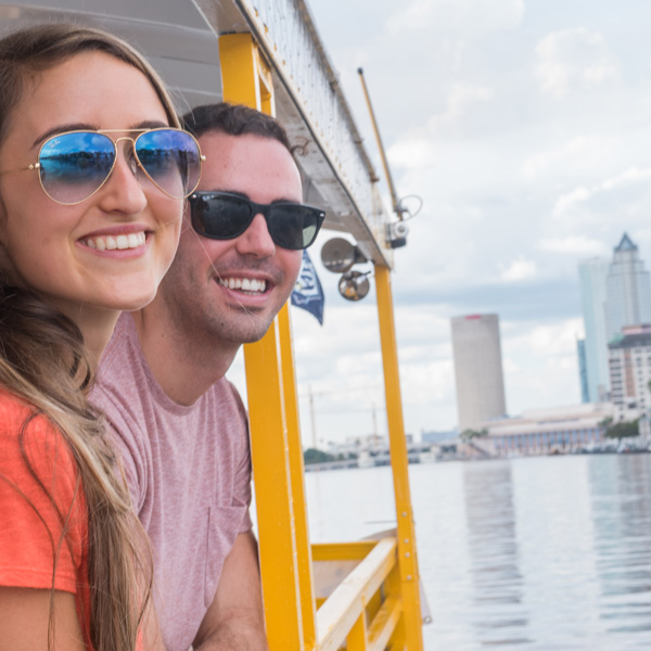 Couple looking out from taxi at Downtown Tampa