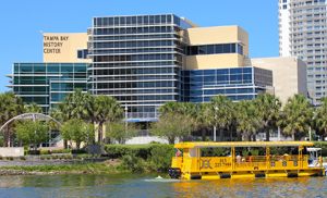 Taxi passing in front of the Tampa Bay History Center